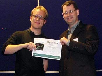 Dr. Rob Evans (Left) receiving the prize from Dr. Ian Day of the University of Sussex